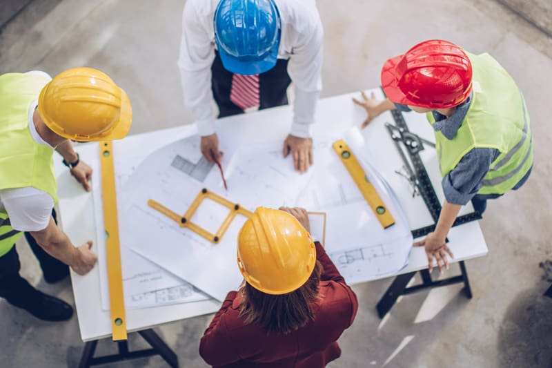 Architects working together at construction site