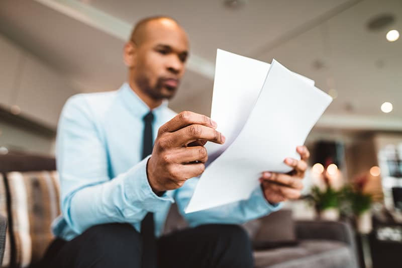 businessman reading over some paperwork